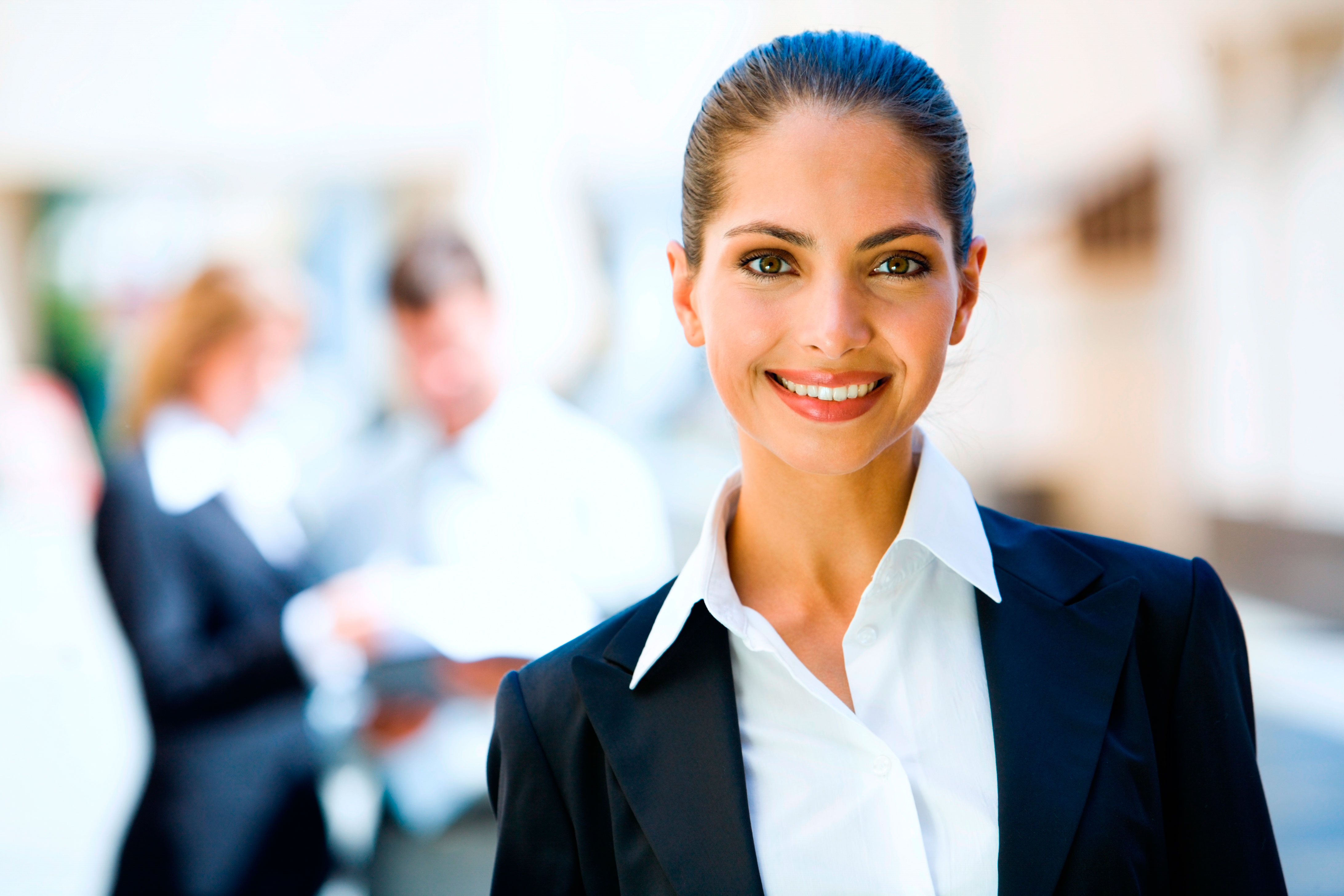 Portrait of a smiling business lady with a combed back hair